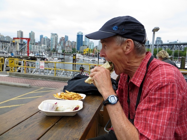 Marathon Mouth chomps down on salmon tacone at Go Fish, Vancouver B.C.