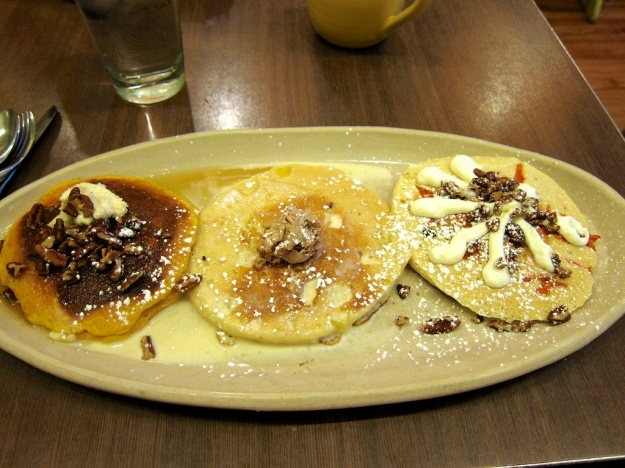 A flight of Snooze pancakes is keeping my stomach grounded