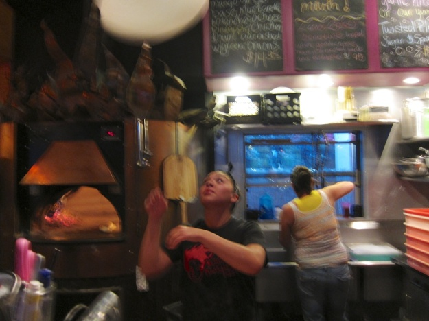 Dough tossing just part of the entertainment at Screaming Banshee Pizza in Bisbee, Arizona