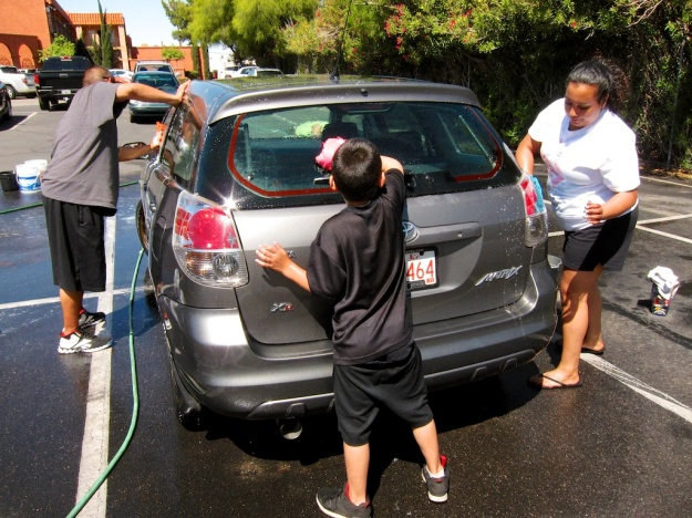 Washing the caked-on sand off my car at a fund-raising carwash in Tucson