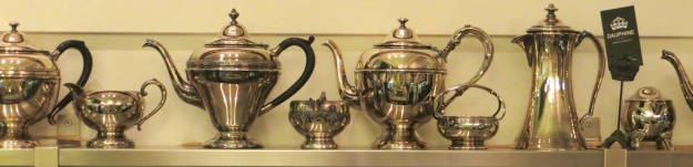 There are lovely antiques like this collection of silver teapots and sugar bowls at Dauphine Bakery & Bistro