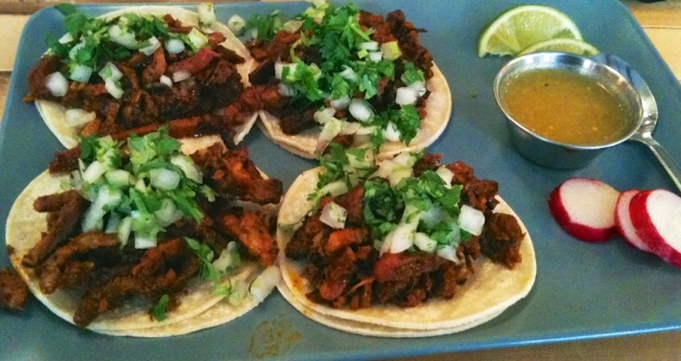 My hands are trembling too much to get a sharp photo of these wonderful al pastor tacos at Tres Carnales Taqueria