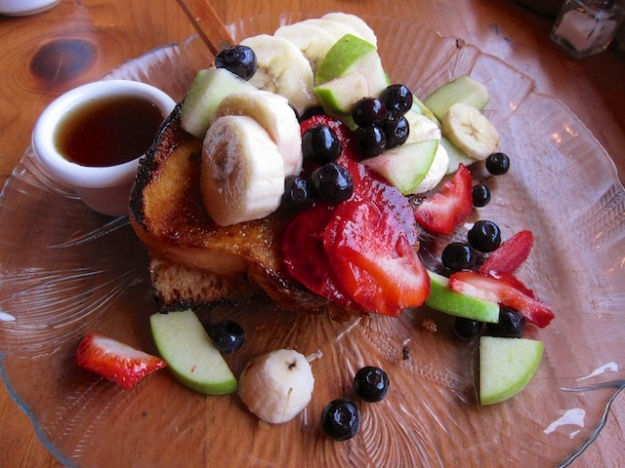 French toast made of house-made sweet bread smothered in fruit at Gutiz