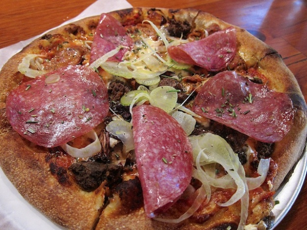 Boar meatballs and rabbit sausage highlight this great thin-crust pie at The Parlor Pizzeria