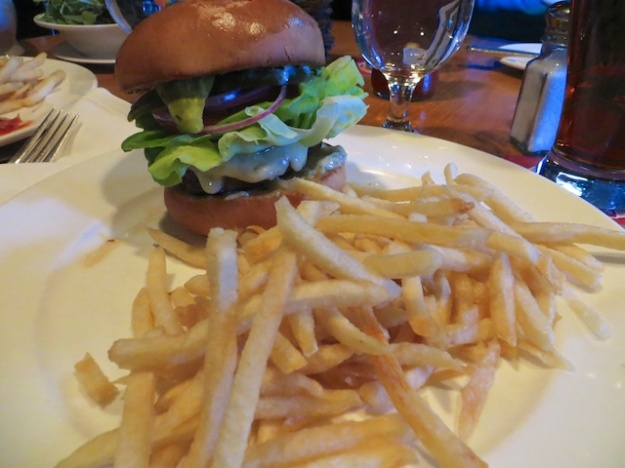 Yes, that's a massive sirloin burger behind the mountain of fries at the Outpost Pub in Lake Louise