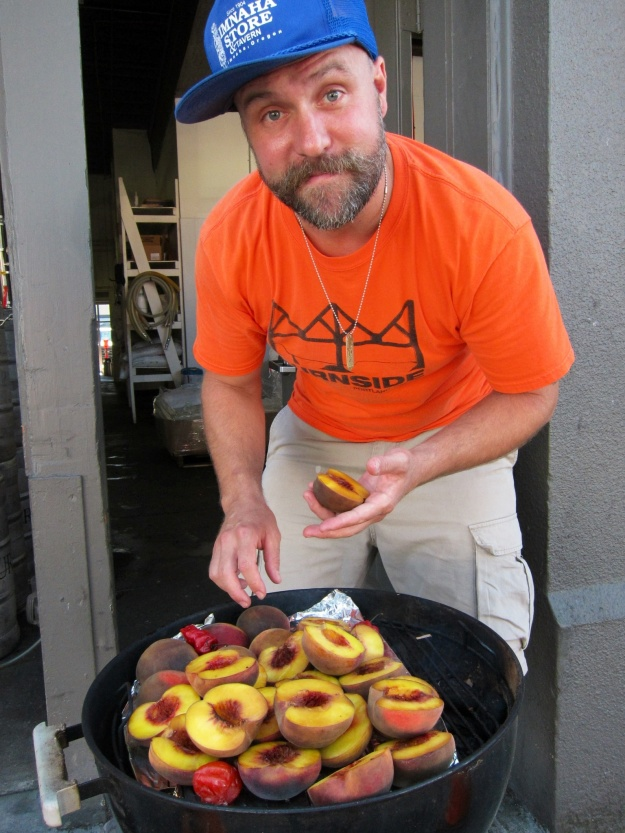 Brewmaster Jason McAdam grills some peaches and Scotch bonnets for a spicy, citrusy beer at Burnside Brewing in Portland