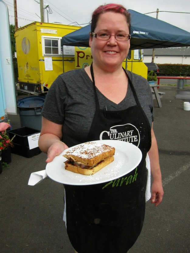 Sarah serves up an amazing egg/French toast concoction at her Egg Carton outlet