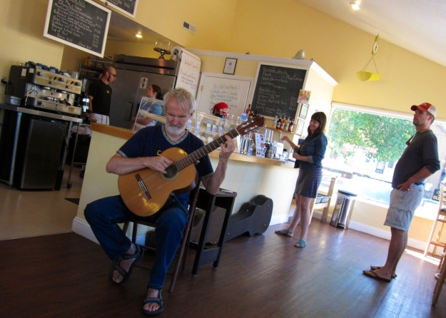 David Ouellette strums a flamenco guitar at Buttercloud  Bakery & Cafe in Medford, Oregon