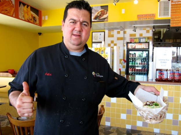 Viva Las Arepas owner Felix Arellano delivers arepas to my table