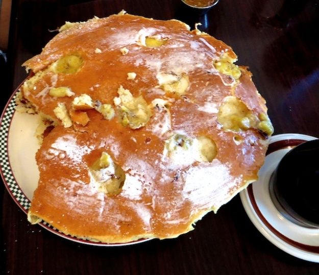 There's another monster pancake lurking beneath this banana-studded linker at Jethro's.