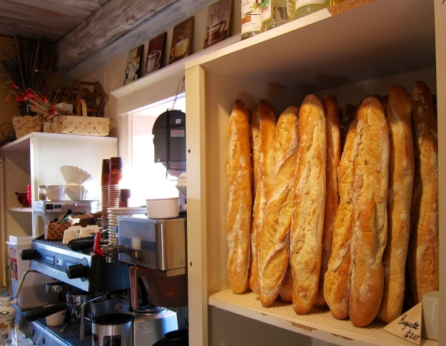 A stack of baguettes amidst all the creative elements at Clafoutis in Santa Fe, New Mexico