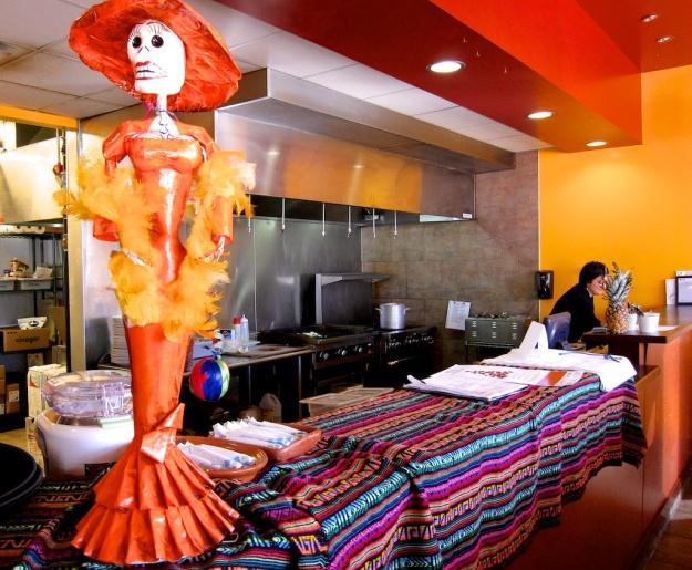 Fantastic papier-mache figurines lend an authentic Mexican touch to Las Maracas
