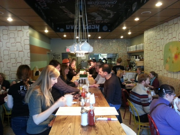 You'll definitely be rubbing shoulders with other diners at Calgary breakfast hotspot OEB