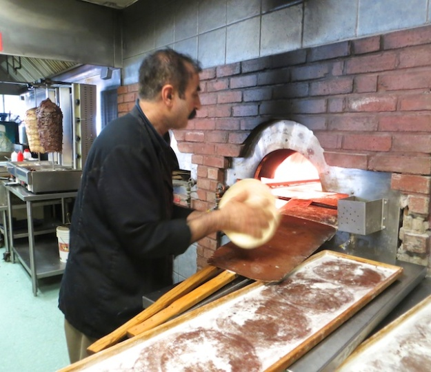 Cooked-to-order pitas heading into the oven at Edmonton's Al Salam Bakery Deli & Restaurant