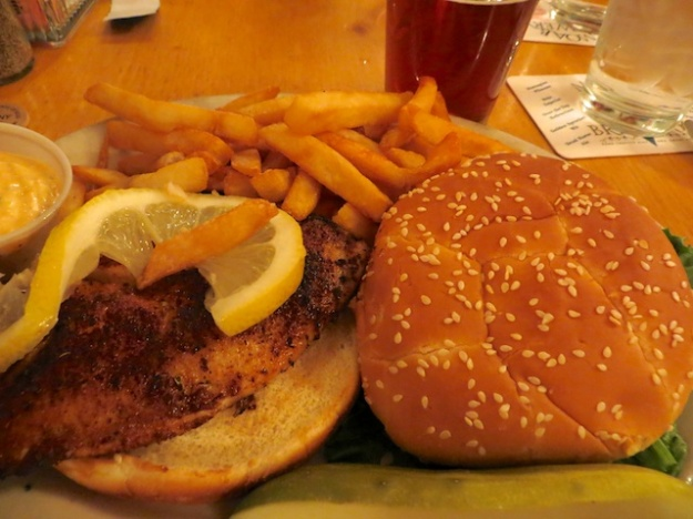 A tilapia sandwich, fries and pint adds up to only $13 at the busy Moab Brewery