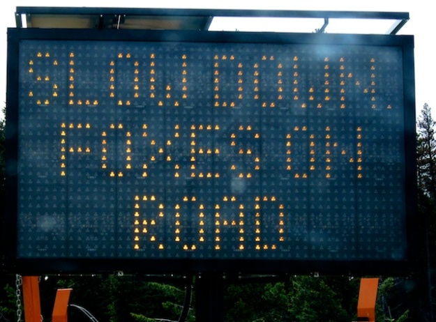 Not a sign you see often: Slow Down, Foxes on Road