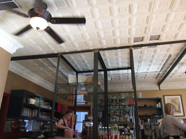 A beautiful stamped-tin ceiling is just one of Lotus Cafe's many charms