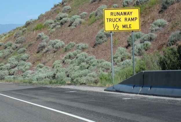 Even better was a 2-1/2 mile runaway lane sign on a twisting, 10-degree slope with, get this, the runaway lane on the LEFT side of the road. Just veer across the oncoming traffic