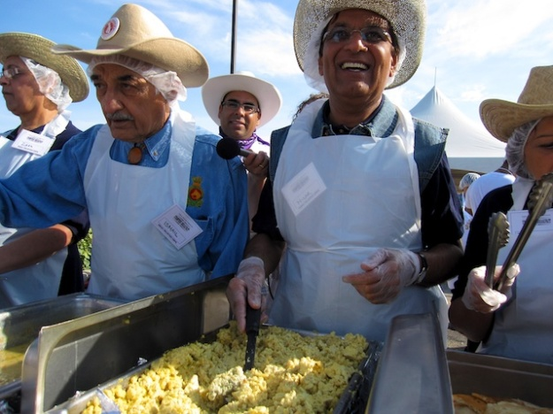 Serving up great eggs and pancakes at the best, most unusual Stampede breakfast, hosted by the local Ismaili community
