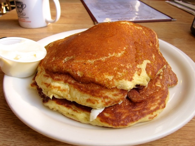 "They're rightly called ""Heavenly Hotcakes"" at Penny Ann's Cafe. These have bacon and eggs in the middle"