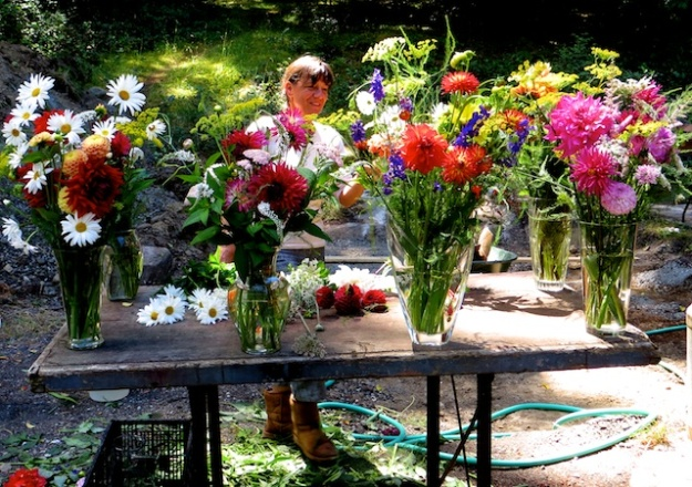 Co-owner Shanti arranges her farm-cut flower bouquets, a bargain $11