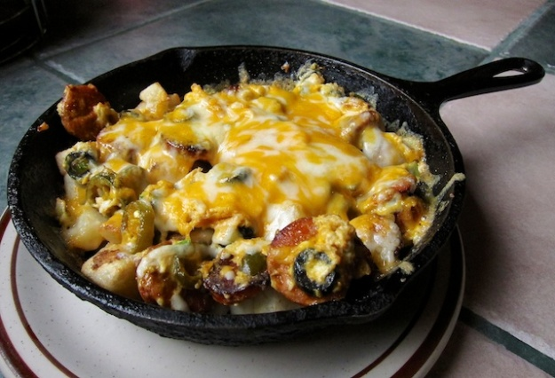 A Mexican scrambler served piping hot in a cast-iron frying pan