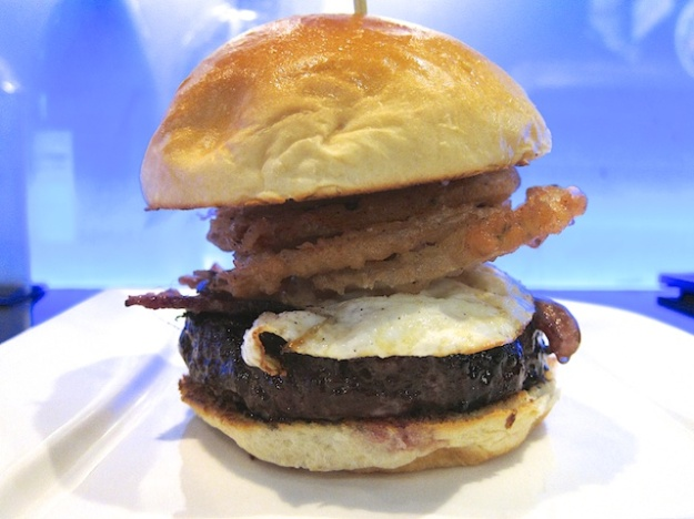 Bachi Burger's glorious wagyu patty, loaded with onion rings and an egg