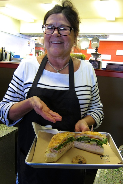 Rubicon Deli owner Cheri Corsiglia presents my half tuna sandwich