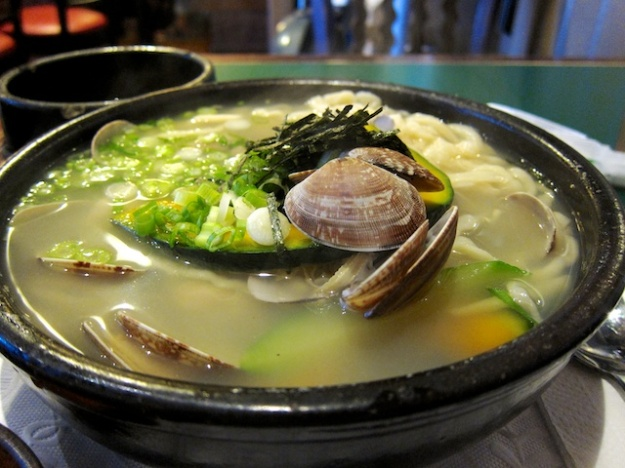 Clams and hand-cut noodles in this lovely bowl at Hangari Bajirak Kalgooksoo