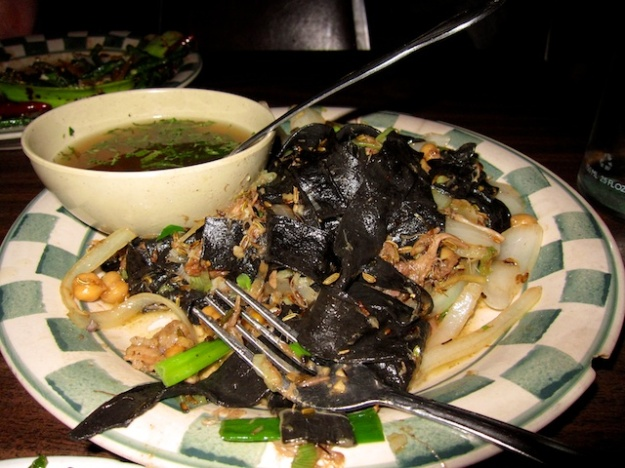 Strange but delicious dishes like squid-ink noodles and chick peas at Mission Chinese Food in San Francisco