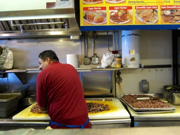 Preparing the meats for the lunch burrito crowd at El Farolito
