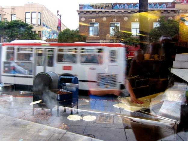 Reflection of Taqueria El Farolito on San Francisco's colourful Mission Street