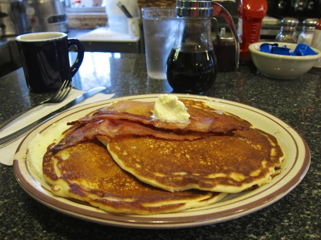 Blueberry pancakes over eggs. Yum!