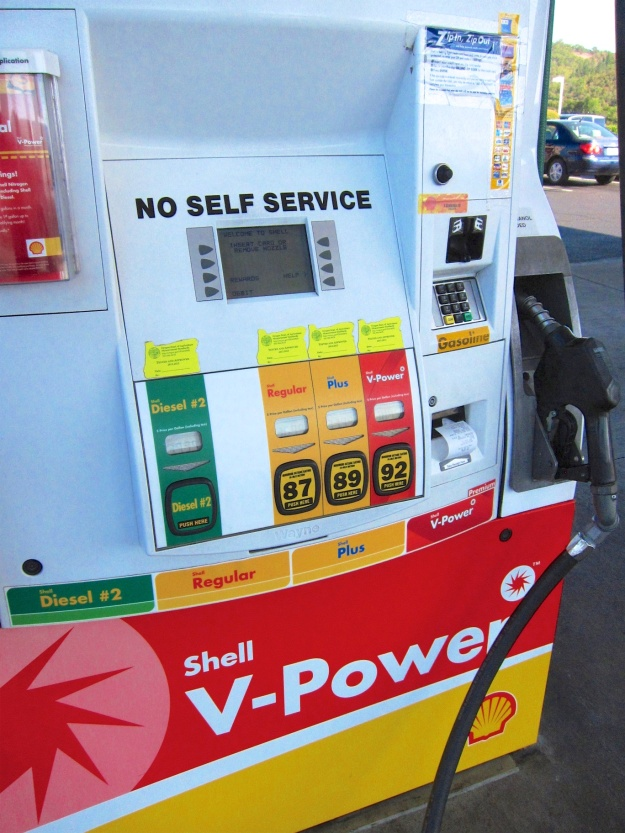 You can't fill your own tank in Oregon but filling up likely won't cost any more than in Canada