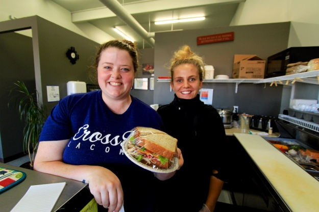 The woman in black is the sandwich magician at Lacombe's Eastside Eatery, assembling this beauty in under a minute