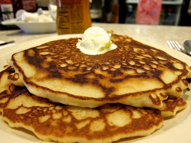 "A perfectly cooked ""short stack"" of pancakes"